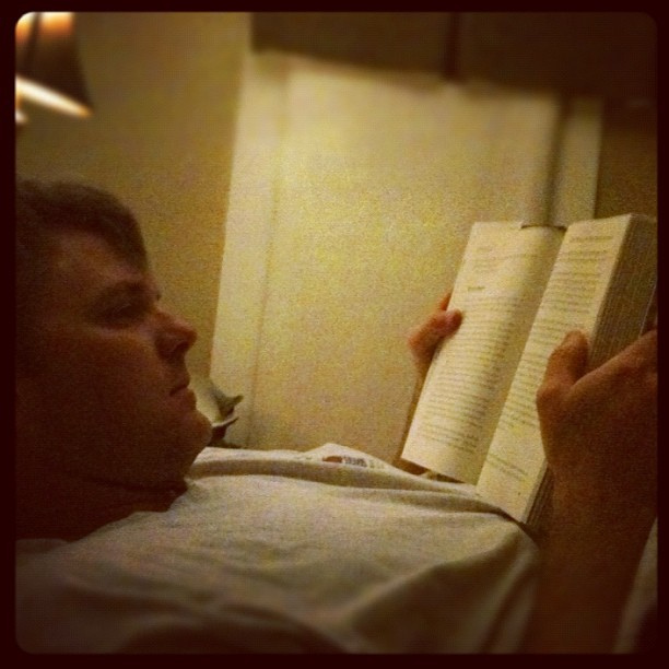 In bed, reading with hubs.