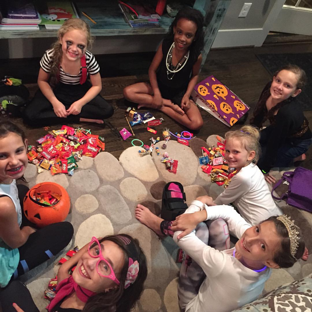 The BEST part of Halloween?! Trading candy with your girls.
